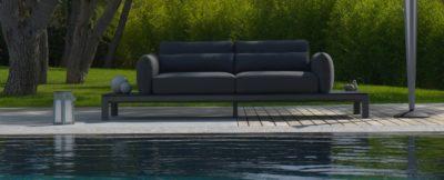 koton platform sofa in grey by a pool